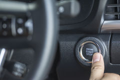 The Finger pressing the Engine start stop button of a car Royalty Free Stock Photos