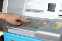 Finger pressing enter after code number insertion on ATM keyboar Royalty Free Stock Photos