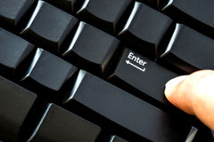 Finger pressing enter key close up Royalty Free Stock Image
