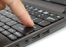 Finger pressing the  Enter  key on a keyboard Stock Images