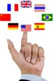 Finger pressing flag Stock Image