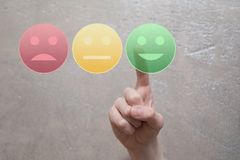 Free Finger Pressing Green Happy Face Button Stock Photography - 119954552