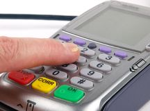 Finger pressing a key on a Payment terminal Stock Photography