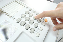 Finger pressing key on phone Royalty Free Stock Photo