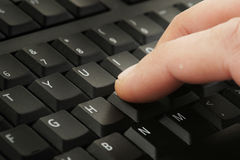 Finger pressing keyboard Stock Photo