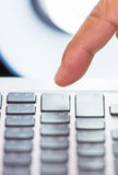 Finger on pressing keyboard Stock Images