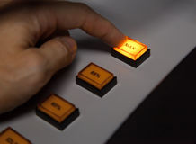 Finger pressing max button. On industrial power control panel. Selective focus Stock Photography