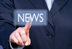 Finger pressing news button. Finger of businessperson pressing news button stock photography
