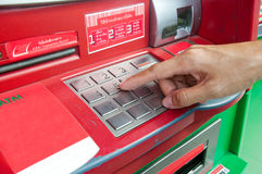 Finger pressing password on ATM machine Royalty Free Stock Photography