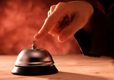 Finger pressing a reception bell Royalty Free Stock Photography