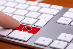 Finger pressing on red button with stop gun sign on it Stock Photos
