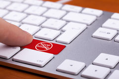 Finger pressing on red button with stop terrorism word and sign Stock Image
