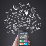 Finger pressing a smartphone, healthy application Royalty Free Stock Photos
