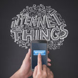 Finger pressing a smartphone with internet of things concept Stock Images