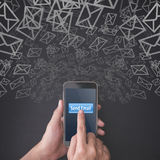 Finger pressing a smartphone with send email concept Stock Photos