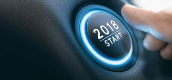 2018 Car Start Button, Two Thousand Eighteen Background. Finger pressing a 2018 start button. Concept of new year, two thousand eighteen. Composite between a Stock Images