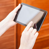 Finger pressing tablet pc in office Stock Photo