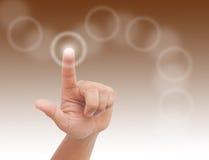 Finger pressing a touchscreen button Stock Photos
