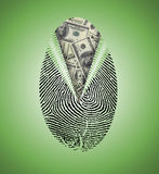 Finger Print reveals currency. Underneath Royalty Free Stock Photo
