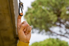 Finger pulling eyelet. Finger pulling the eyelet of a nylon cord under a balcony in the garden royalty free stock image