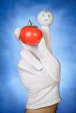 Finger puppet holding tomato Royalty Free Stock Image
