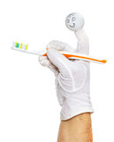 Finger puppet holding tooth brush Stock Photo