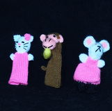 Finger Puppets. Children`s knitted finger puppets with a monkey, a mouse and a cat Stock Photography