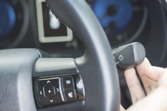The Finger Push a button on the car steering wheel Stock Photography