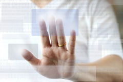 Finger push button on screen Royalty Free Stock Image