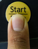 Finger push the button Stock Photography