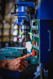Finger push on red emergency stop switch milling machine Royalty Free Stock Photo