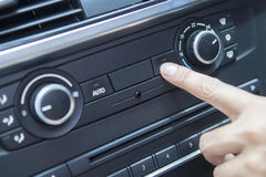 Finger pushing the air conditioner button Stock Images