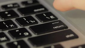 Finger pushing the button ENTER on the keyboard stock footage