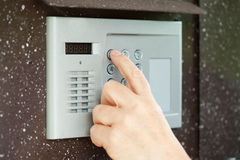 Finger pushing button of  intercom. Human finger pushing button of house intercom Stock Image
