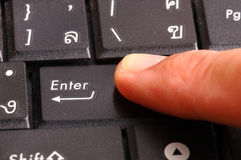 Finger pushing the button of keyboard Royalty Free Stock Image