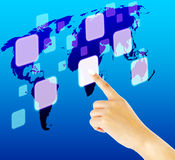 Finger pushing button on a touch screen interface. With world map Stock Image