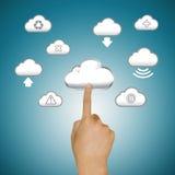 Finger pushing cloud icons. Blue background Stock Photo