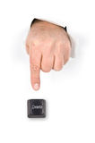 Finger pushing delete key. Stock Photo