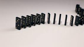 Finger pushing dominoes