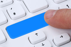 Finger pushing empty button on computer internet online Royalty Free Stock Photos