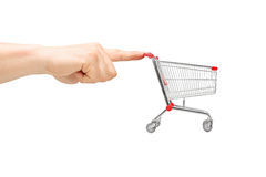 Finger pushing an empty shopping cart Royalty Free Stock Photography