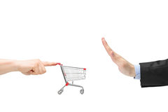 Finger pushing an empty shopping cart and male hand gesturing st Stock Images