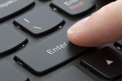 Finger pushing enter black button Stock Photos
