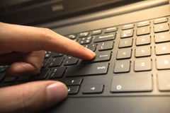 Finger pushing the Enter button of keyboard Stock Images