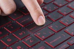 Finger pushing enter button on laptop keyboard Royalty Free Stock Photos
