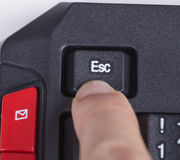 Finger pushing ESC button on keyboard of computer Royalty Free Stock Images