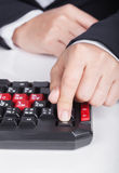 Finger pushing ESC button on keyboard of computer Royalty Free Stock Photography
