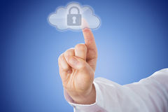 Finger Pushing Lock Button In Cloud Icon Over Blue. Raised male right index finger is pushing a transparent cloud button from behind. The highlighted cloud Stock Photos