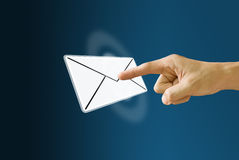 Finger pushing the mail icon Stock Photos