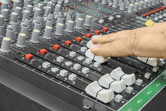 Finger pushing a mixing desk slide. Selective focus Royalty Free Stock Photography